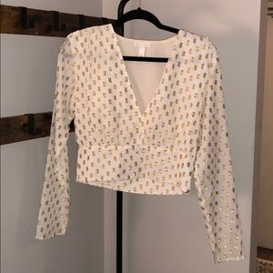 White and gold long sleeve blouse